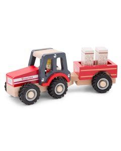 roter Holzspielzeuge-Traktor mit Hänger und Ladung